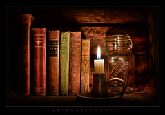Cubby (J Michael Hamon) Tags: stilllife dark light shadow book books candle fire flame jar vignette photoborder hamon nikon d7100 nikkor 1855mm lowkey fractal fractalius