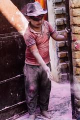 Boy Covered in Pink Gulal (AdamCohn) Tags: abeer adamcohn hindu india vrindavan gulal holi pilgrim pilgrimage अबीर गुलाल होली