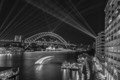 sydney harbour (Greg Rohan) Tags: longexposure nightphotography laserbeam beam beams nightlights lights lightfestival festival vivid laser architecture city cityscape skyline monochrome blackwhite blackandwhite bw sea ocean water bridge sydneyharbourbridge sydneyharbour harbour australia sydney d750 2018 nikon nikkor building night