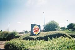 burger king sign (johnnytakespictures) Tags: disposable disposablecamera singleuse smile pocketsocket 35mm film analogue coventry westmidlands summer sun sunshine burgerking restaurant burger fastfood sign logo trademark centralsix