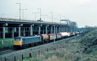 What a great consist....a proper mixed freight....you don't see em like this now....mores the pity.....7F86 85101 Willsden-Warrington Arpley nr Bescot 16-03-1988