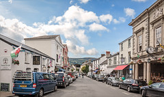 Crickhowell, Wales (PhredKH) Tags: canonphotography flag fredknoxhooke fredkh hillside photosbyphredkh phredkh splendid streetphotography wales cars clouds outdoorphotography people peoplewatching sky streetscene