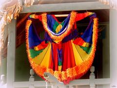 garment (milomingo) Tags: multicolored garment clothing bright bold vivid vibrant textile renfair bristolrenaissancefair retail merchandise knit outdoor wares sign display photoborder