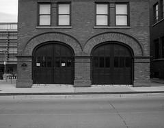 The Fire Department (Alex Luyckx) Tags: cambridge ontario canada galt downtown historicdowntown architecture buildings history johngalt ccr classiccamerarevival ccrgasmeetii meetup photowalk social meet photographers minolta minoltaxe7 slr 135 35mm minoltamdwrokkorx28mm128 ilford ilfordfp4 fp4 asa125 pyrocathd 11100 photographersformulary bw blackwhite epsonv700 adobephotoshopcc film filmphotography believeinfilm filmisalive filmisnotdead