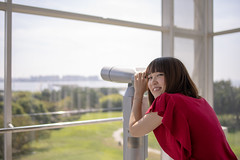 Young woman having fun with telescope in public park (Apricot Cafe) Tags: img107140 asia asianandindianethnicities japan japaneseethnicity kasairinkaipark tamronsp35mmf18divcusdmodelf012 tokyojapan autumn beautifulwoman capitalcities casualclothing charming colorimage copyspace dating day enjoyment glass happiness healtylifestype indoors leisureactivity lifestyles lookingatcamera lookingovershoulder nature oneperson oneyoungwomanonly onlywomen people photography publicpark realpeople shortsleeved smiling straighthair telescope tourism tourist transparency waistup window women youngadult