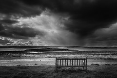 Sea Storm (Pete Rowbottom, Wigan, UK) Tags: black white blackandwhite monochrome bench stormclouds seastorm northumberland holyisland lindisfarne landscape sea ocean cross island uk britain england art dramatic cloudscape nikond810 lightanddark light rain badweather coast shoreline coastlineuk uklandscape ukcoast ukcoastline ukbeaches lonebench peterowbottom ukweather summer beach contrast