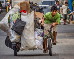 Pedicab Recycler (FotoGrazio) Tags: poverty bicycle malate travelphotography labor fotograzio strain trash waynegrazio heavy streetphotography manila intense business pedicab slippers pedalpower waynesgrazio streetscene hardwork socialdocumentaryphotography footware philippines heavyload determination difficult man poor waynestevengrazio transportation travel feet makingaliving filipino focused overflow recycling street lifeinthephilippines recycle