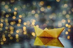 Sail into Magic (flashfix) Tags: september102018 2018inphotos flashfix flashfixphotography ottawa ontario canada nikond7100 40mm macro bokeh lights origami boat puddle rainydayfun 2minutemacro texture light sail reflection stilllife paper origamiboat