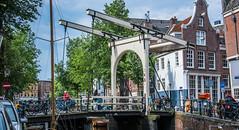 2018 - Amsterdam - Drawbridge - 2 of 2 (Ted's photos - For Me & You) Tags: 2018 amsterdam cropped nikon nikond750 nikonfx tedmcgrath tedsphotos vignetting drawbridge dutchdrawbridge bikes bicycles bridge canal railing railings
