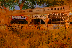 A Graffiti Covered Old Tunnel Entrance Bathed by Orange Streetlights' Glow (@mjmantis Montreal Urban Photos) Tags: montreal graffitiart tunnel abandoned canada streetlights urbanart streetphoto streetart graffiti mtl nighttime streetphotography urban explorecanada urbex urbanphotography citylights