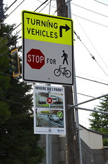 Turning vehicles (afagen) Tags: seattle washingtonstate capitolhill sign