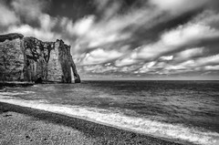 "fine art black and white, white clouds stream over the Porte d'Aval - Arch of Aval - at the south end of Etretat, Seine-Maritime, Normandy, France (grumpybaldprof) Tags: étretat seinemaritime hautenormandie normandy france arches ""portedaval"" ""portedamont"" ""portedemanneporte"" laiguille ""theneedle"" ""eugèneboudin"" ""gustavecourbet"" ""claudemonet"" ""paysdecaux"" ""alabastercoast"" ""chapellenotredamedelagarde"" ""thewhitebird"" ""loiseaublanc"" ""lachapellenotredamedelagarde"" ""falaised'amont"" ""thegardensofetretat"" ""lesjardinsd'etretat"" alabaster white cliffs needles bw blackwhite ""blackwhite"" ""blackandwhite"" noireetblanc monochrome ""fineart"" ethereal striking artistic interpretation impressionist stylistic style contrast shadow bright dark black illuminated arch ""naturalarch"" clouds streaming drama mood atmosphere canon 70d ""canon70d"" tamron 16300 16300mm ""tamron16300mmf3563diiivcpzdb016"""