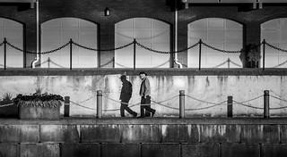 Friends walk alone