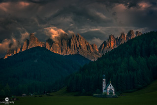 The calm comes after the storm. Church of San Giovanni in Ranui front of Odle Group in Val di Funes (Bolzano, Italy)