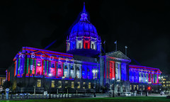 city hall being remapped for the 2018 global climate action summit (pbo31) Tags: bayarea california nikon d810 color september 2018 city urban boury pbo31 summer sanfrancisco night dark black art roadway panorama large stitched panoramic cityhall civiccenter red white blue illuminated projection light casting graph remapping architecture globalclimateactionsummit polk 911 memorandum commemorating 17th anniversary tribute usa