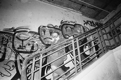 Hannah in the pigeon den (esmeelily) Tags: 35mm film analog lomo lomography grain ilford black white is dead urbex derelict abandoned building raf upwood graffiti spraypaint street art vandalism tag tagging olympus trip af 50