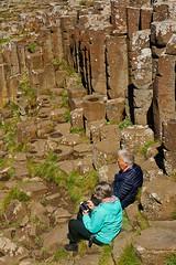 Giant's Causeway (abtabt) Tags: unitedkingdom uk northernireland sea ocean giantscauseway stone basaltcolumns worldheritage man woman rest d70028300 senior causeway