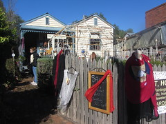 The Art of Craft, Main St., Maldon, Victoria. (d.kevan) Tags: people signs shops bricabrac clothes objects curiosities fences verandahs tables stands pots wroughtironstructures windows weatherboard doors plants maldon mainst victoria traditionalarchetecture outsideshops