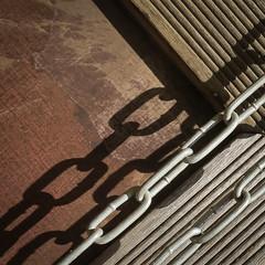 Chain and Shadow (coastwalker) Tags: abstrakt hamburg square wilhelmsburg chains wood shadow lines coastwalker