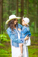 Family Ideas. Loving and Positive Caucasian Mother with Her Little Daughter Posing  Together in Green Summer Forest. (DmitryMorgan) Tags: 2 35years 3035years activity adorable adult baby caucasian cheerful child childhood communication daughter denim enjoying forest forested fun garden girl green greenish hold jeans joy kid laugh life love mother outdoors parent park people recreation relationship smiling summer summertime sun talking teamwork tenderness thirties together togetherness two unity wife woman young