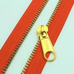 M56 Toni golden sliders! (tonizippers) Tags: zippers zipper zip zipfasteners zipperfasteners tonizippers toni tonislider tonisliders manufacturers manufacturer manufacturing fasteners sliders slider