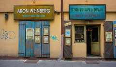 Shops in Kazimierz (bobinskiii) Tags: krakow cracow poland europe european polish europeanunion eu city cities town towns old historic architecture building buildings structure structures kazimierz shop shops door doors signs shutters brown blue