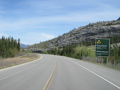 Approaching a wildlife crossing caution sign in our family RV (jimbob_malone) Tags: 2018 highway16 alberta