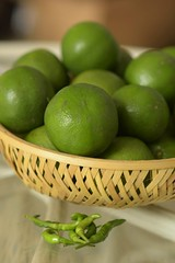 Todays Harvest from the garden (Vidya...) Tags: lemons green chillies wicker basket garden