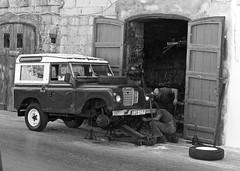 Landrover repair (alicejack2002) Tags: landrover landy bw valletta classiccar defender malta garage