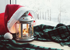 bigstock--155420807 (ceneje.jeftinije) Tags: winter home christmas new year window lantern warm candle snow decor fire light interior white mood decoration iron decorative calm trees celebration windowsill flame house tranquil landscape frosty frost park forest colorful january february december nature background metal santa claus hat red comfortable green wooden blanket wrap scarf festive