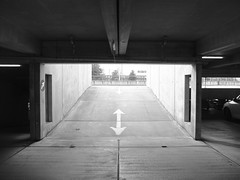 up or down ? (larsniel) Tags: parking arrow building architecture concrete denmark brøndby confusing sign signage up down fuji x10 bw