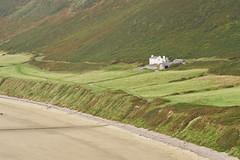 Location, location, location (Michael J Lawlor) Tags: zuikoom200mmf4 wales gower rhossili house beach