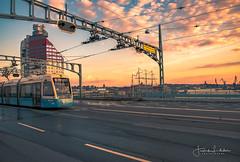 This is Gothenburg (Fredrik Lindedal) Tags: gothenburg visitgothenborg visitsweden tram train bridge building sunset sunlight sun cloudsstormssunsetssunrises skyline city cityview cityscape nikon d750 lindedal