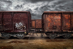 through the wagons (dim.pagiantzas | photography) Tags: wagons wagon train trains railroad rails cargo transportation vehicle rust wood wooden metal textures atmospheric light ambient old abandonment abandoned sky rainy clouds cloudy canon ground wheels container transport