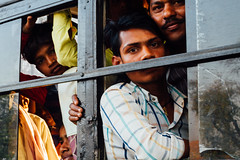 Faces in Bus Window, Mathura India (AdamCohn) Tags: adamcohn india mathura vrindavan holi wwwadamcohncom
