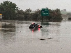 I-25 near HWY 34. The driver escaped as flood waters rose on to road on September 13, 2013. (Colorado State Patrol)