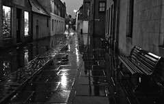 street in the rain (johnny_9956) Tags: orkney stromness scotland street rain bench buildings urban night blackandwhite