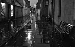 street in the night (johnny_9956) Tags: orkney stromness scotland street rain bench buildings urban night blackandwhite