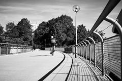 Bridge cycling (iamunclefester) Tags: münchen munich blackandwhite monochrome bike bicycle bridge street lamp