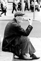 Taking a breather, Dublin (Sean Hartwell Photography) Tags: dublin irelan man smoke smoking street candid sitting urban