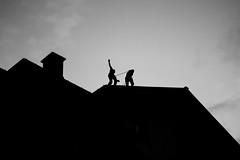 La marche des funambules (MEOT Youri) Tags: équilibre silhouette contrast dark sombre bw nb climb grimpe street rue