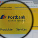 Postbank logo on a computer screen with a magnifying glass.jpg