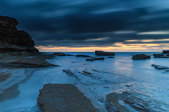 A Luminescent Shimmering Blue Dawn Seascape (Merrillie) Tags: daybreak theskillion nature australia terrigal rocky morning sea waterscape newsouthwales rocks earlymorning nsw coast landscape ocean dawn cloudy sunrise coastal clouds outdoors seascape waves centralcoast water sky