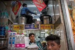 Maximizing Space in Old Delhi (shapeshift) Tags: plasticbottles waterbottles storefront restaurant 50mm18 50mm nikon travel olddelhi kitchen candidphotography people davidphamsf davidpham shapeshift shapeshiftnet streetphotography newdelhi delhi india in urban documentary storiesofindia indiastories