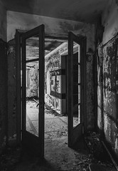 Walking Around The Corridors Of The Remains... (panos_adgr) Tags: nikon d7200 monochrome bw abandoned hotel radion kamena vourla greece travel photography building architecture doors windows ambient light textures wall view