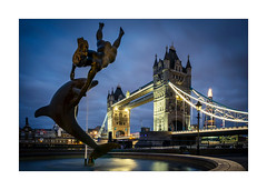 The Girl, The Dolphin and the London Icon (Dave Fieldhouse Photography) Tags: tower towerbridge london citycentre city cityscape fountain pool riverthames thames bridge morning dawn predawn clouds summer shard theshard lights longexposure fujifilm fuji fujixt2 dusktilldawn wwwdavefieldhousephotographycom statue night nighttime landmark greatbritain uk capital