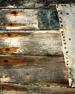 Boat detail with wood, iron oxide, and metal