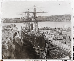 a2825357 (State Library of New South Wales collection) Tags: naval ships navy french atalante ironclad pacific sydney sydneyharbour fitzroy dock statelibraryofnewsouthwales holtermann beaufoy merlin cockatoo biloela island corvette drydock gravingdock cockatooisland shipyard ship warship frenchnavy marinenationale fitzroydock