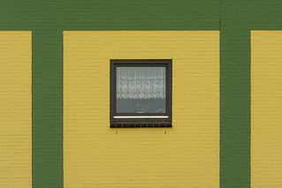 Window in a green and yellow wall