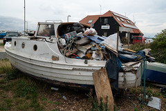 Once Upon a Time There was a Little Family Boat (fstop186) Tags: onceuponatime sad boat rubbish wreck litter pleasure happy memories neglect decay day family ropes paper plastic solent plywood wood swimming fishing rnli lifeboatstation beach stones documentary record rotten news endofanera